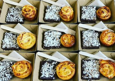 Red lentil brownie with toasted coconut and caramelised onion, ham and cheese scrolls.
