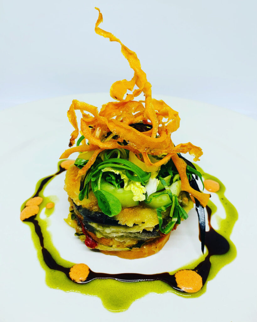 Vegetable stack on a white plate.