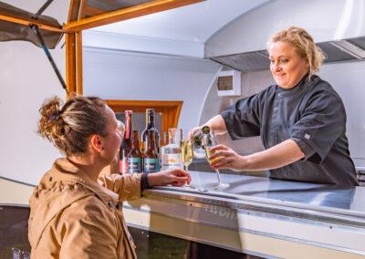 Caroline serving drinks from the MBV Foods Food Van